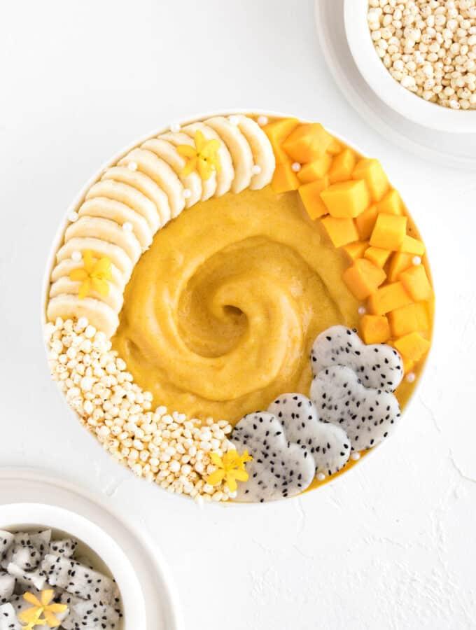 mango banana smoothie in a white bowl