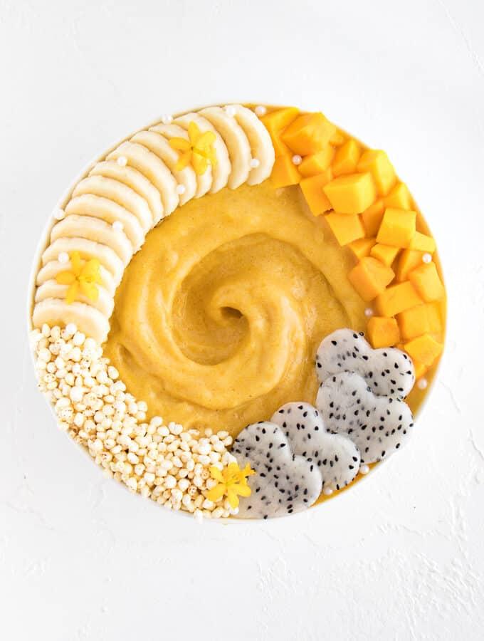 mango banana smoothie in a yellow bowl