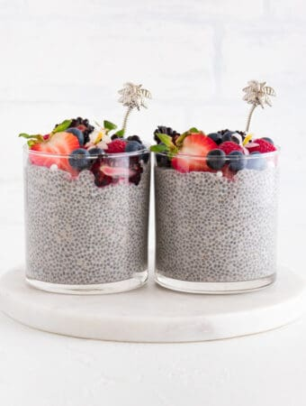 two cups of vanilla chia pudding topped with berries