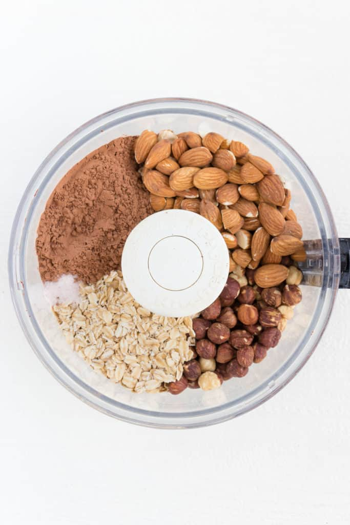 almonds, cacao powder, rolled oats, hazelnuts, and salt in a food processor