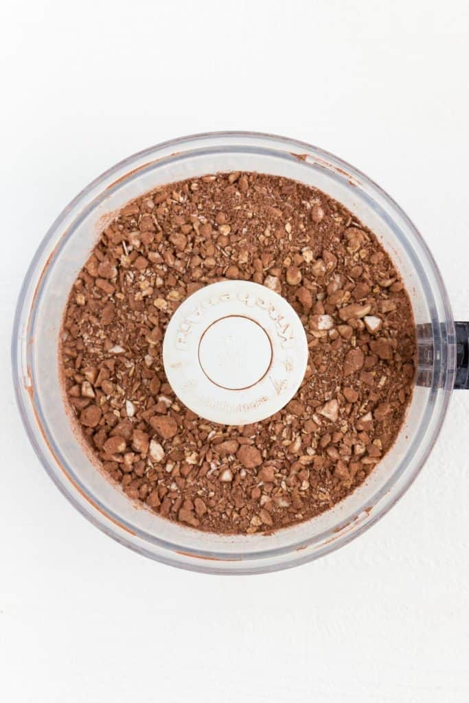 cacao powder, rolled oats, and nuts blended inside a food processor