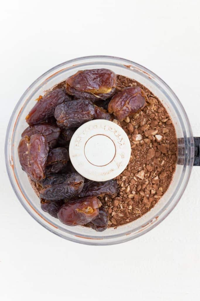 medjool dates and cacao powder inside a food processor
