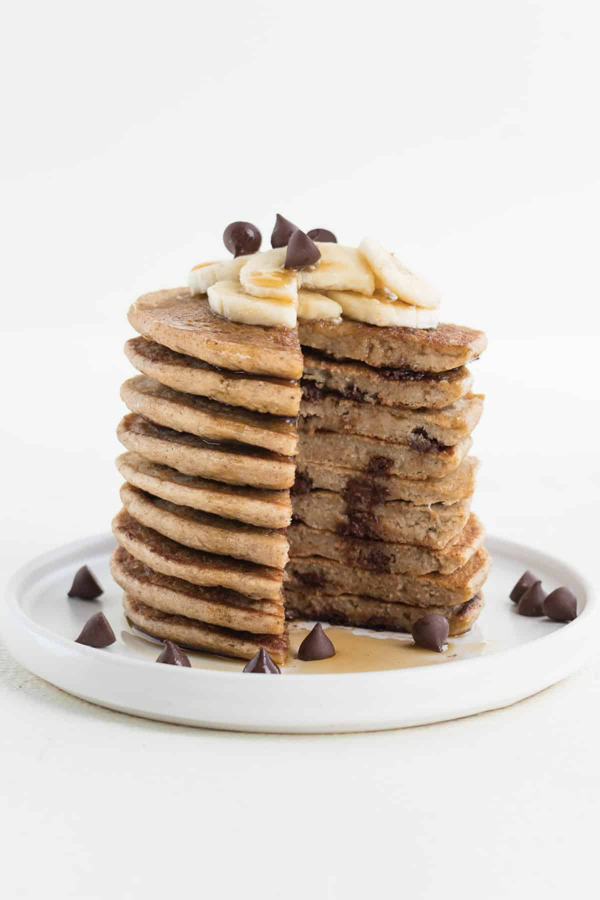 a sliced stack of banana pancakes with chocolate chips and banana