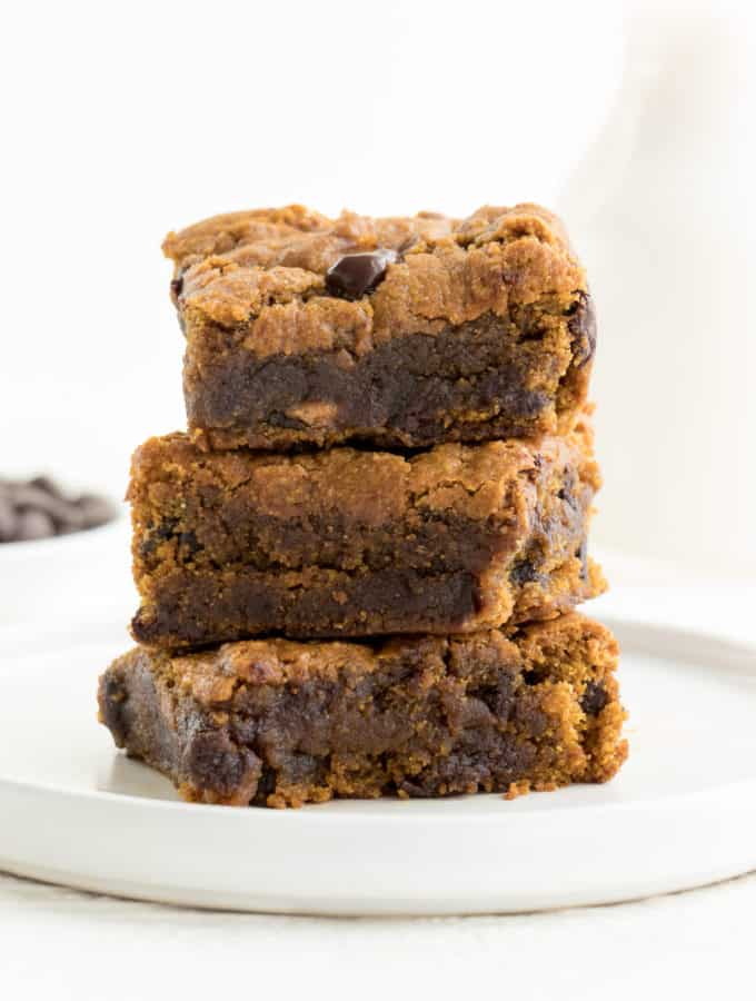 chocolate chip pumpkin bars stacked on a small white plate