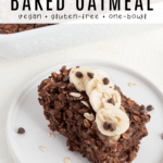 slice of chocolate baked oatmeal topped with sliced banana and chocolate chips on a white plate