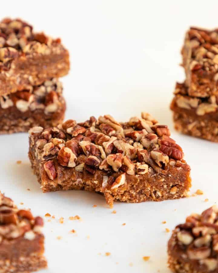 a no-bake pecan pie bar with a bite taken out of it