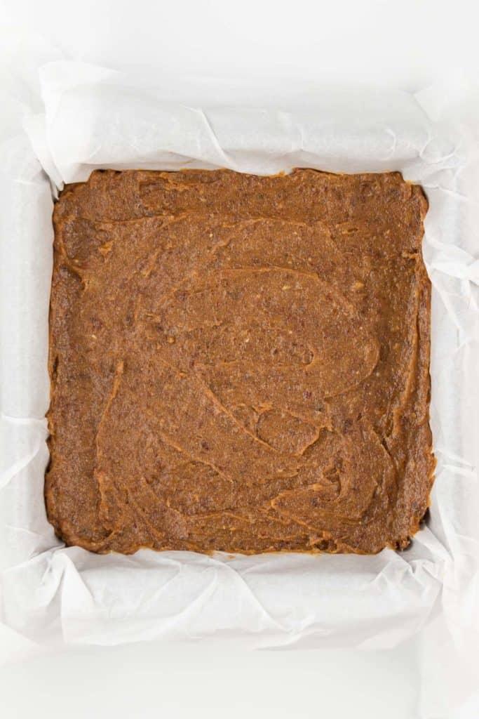 caramel spread across a square baking dish