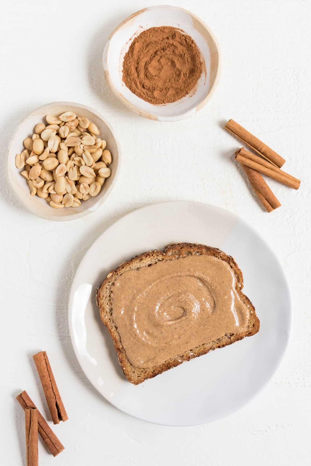 pumpkin spice peanut butter on top of toast with cinnamon and peanuts