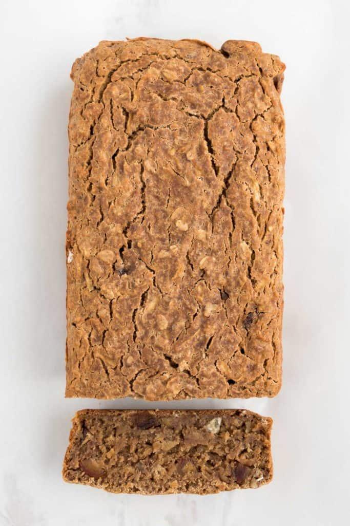 baked vegan apple cinnamon bread with one slice remove