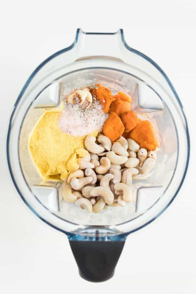 cashews, sweet potato, nutritional yeast, salt, and garlic inside a blender