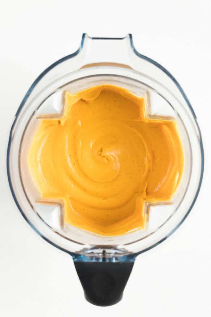 orange cheese sauce inside a blender