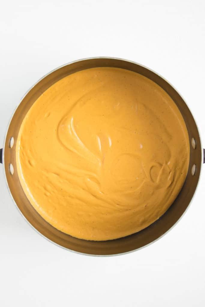 orange cheese sauce inside a saucepot