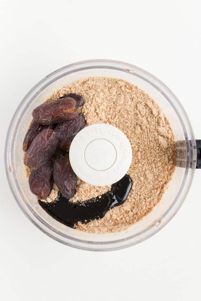 medjool dates, molasses, and flour inside a food processor