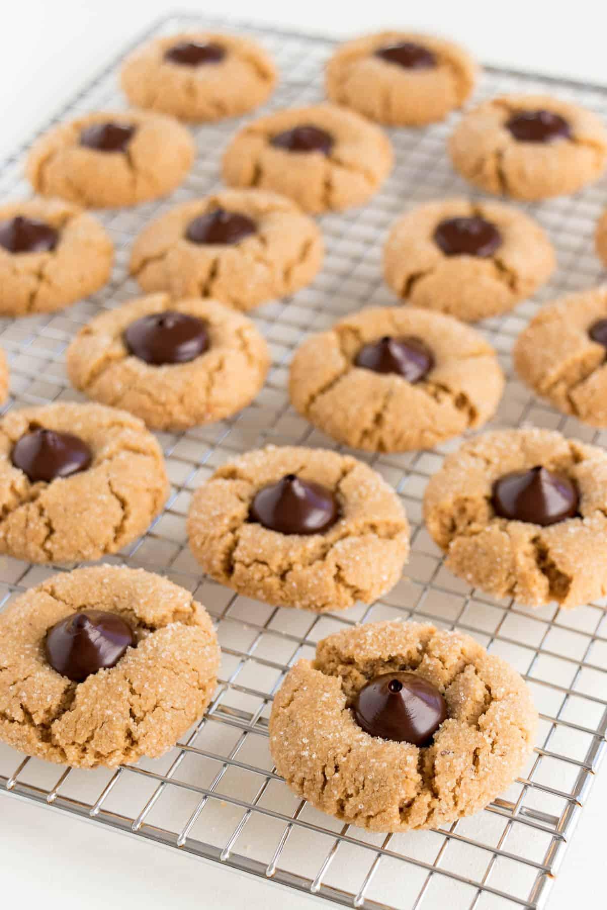 vegan peanut butter thumbprint cookies on a metal cooling rack