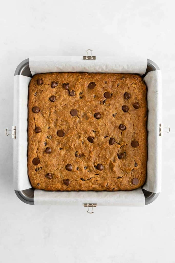 chocolate chip banana blondie batter in a square baking dish