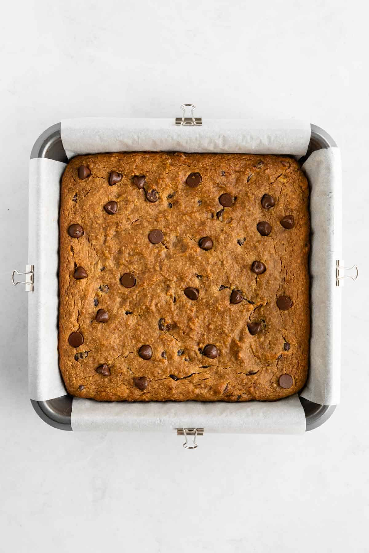 baked healthy banana bars with chocolate chips in a square baking dish