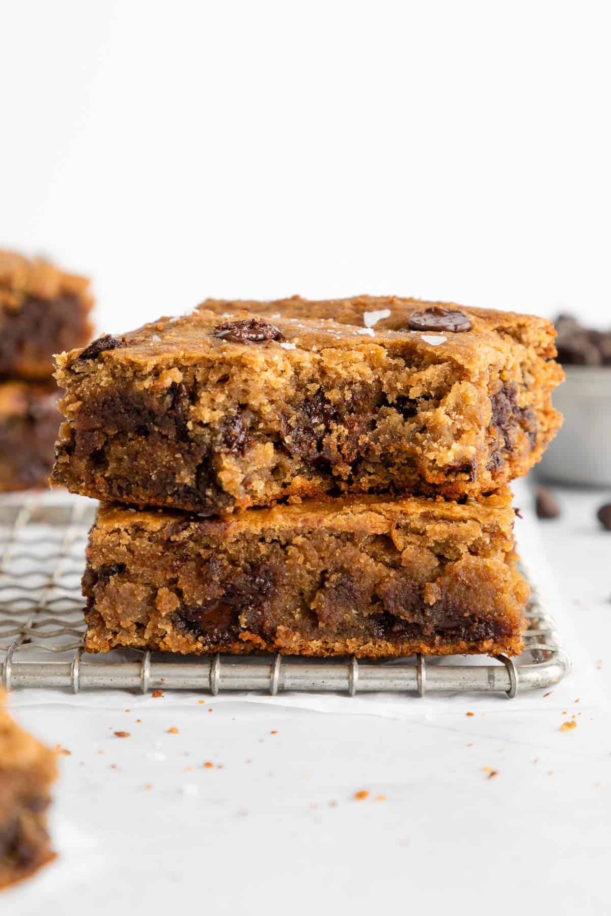 a stack of four chocolate chip banana blondie bars