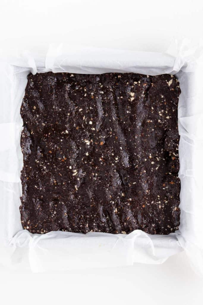 no bake brownie dough inside a square baking pan