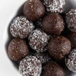 chocolate coconut energy balls inside a white bowl
