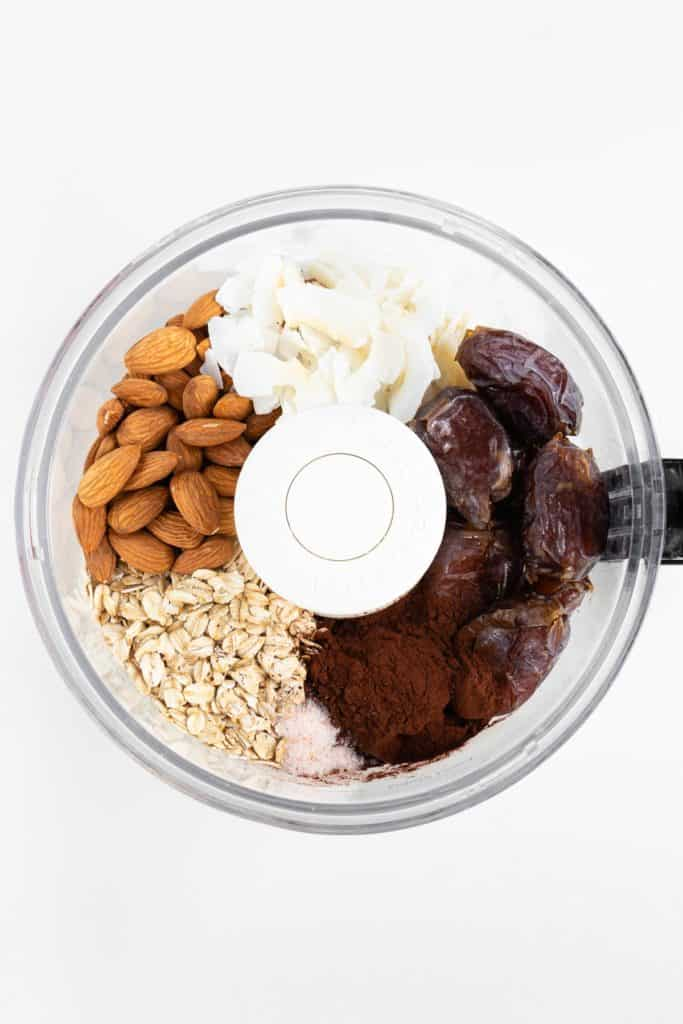 almonds, coconut flakes, oats, medjool dates, and salt inside a food processor
