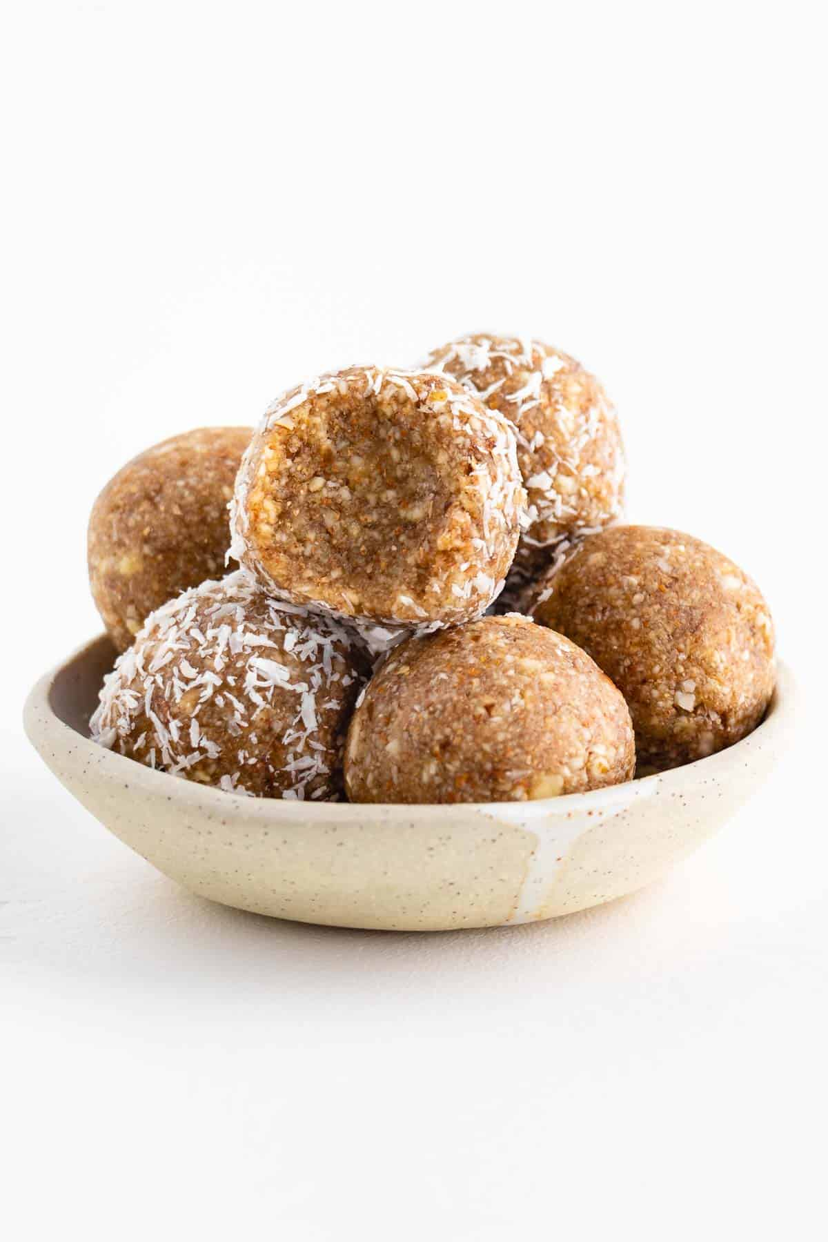 a stack of no-bake balls in a small ceramic bowl