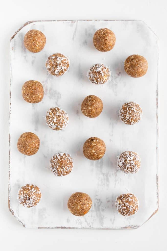 energy balls on a white distressed cutting board