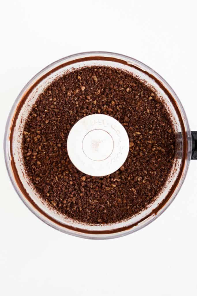 cacao powder and nuts blended inside a food processor