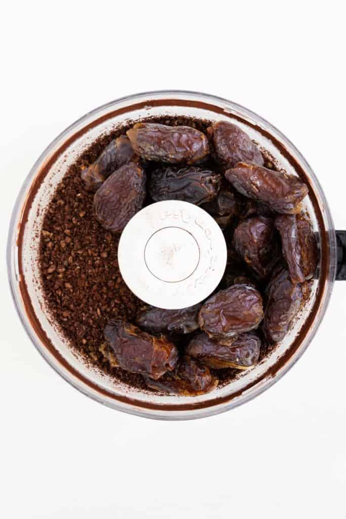 cacao powder and medjool dates inside a food processor
