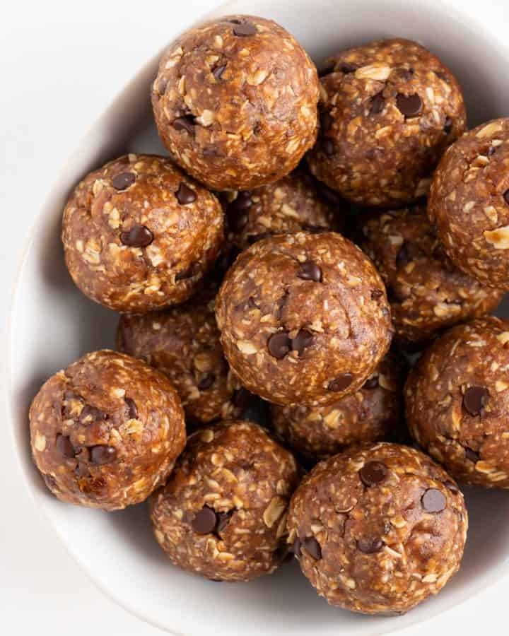chocolate chip oatmeal cookie dough balls inside a white bowl