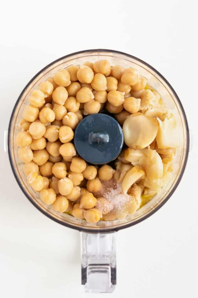 garbanzo beans and salt inside a food processor