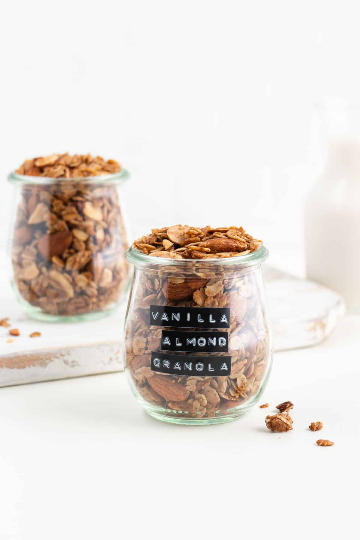 two glass jars filled with vanilla almond granola