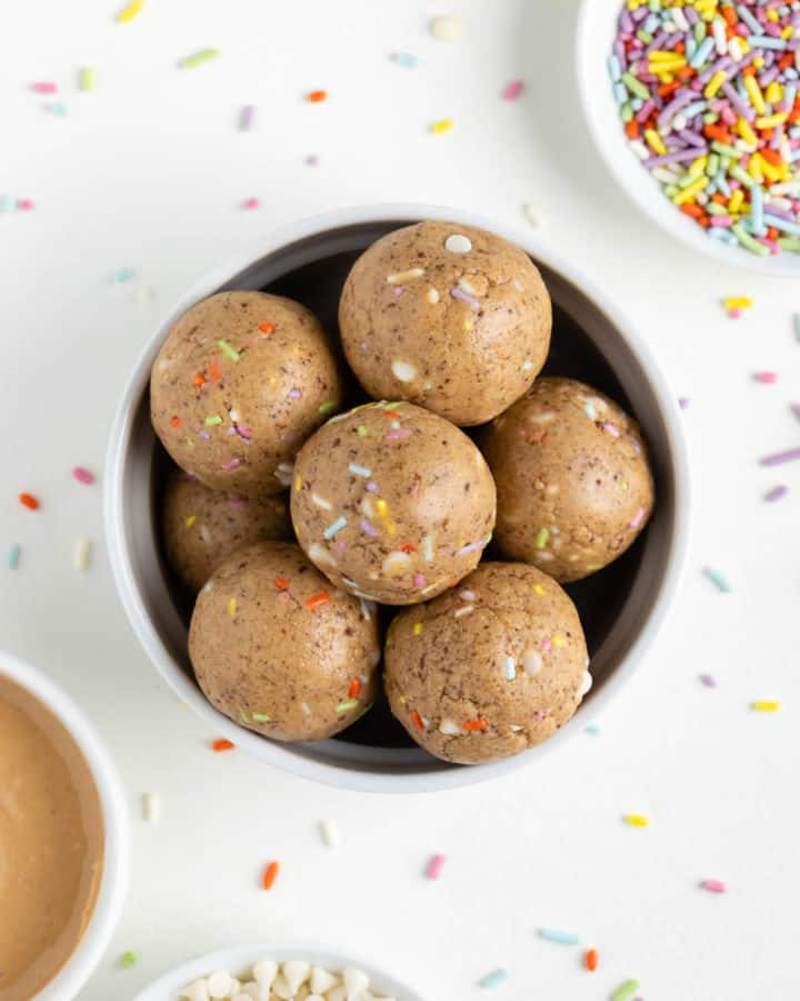 a bowl filled with birthday cake energy balls