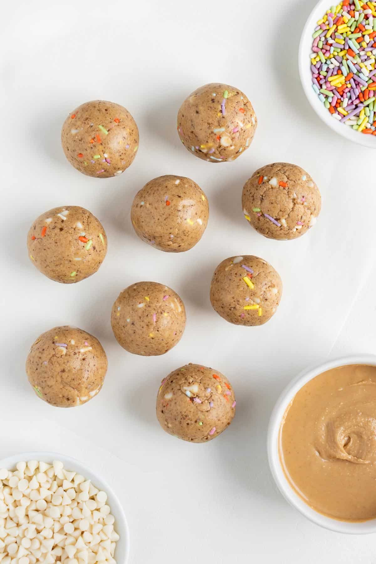 birthday cake energy balls with white chocolate chips and sprinkles