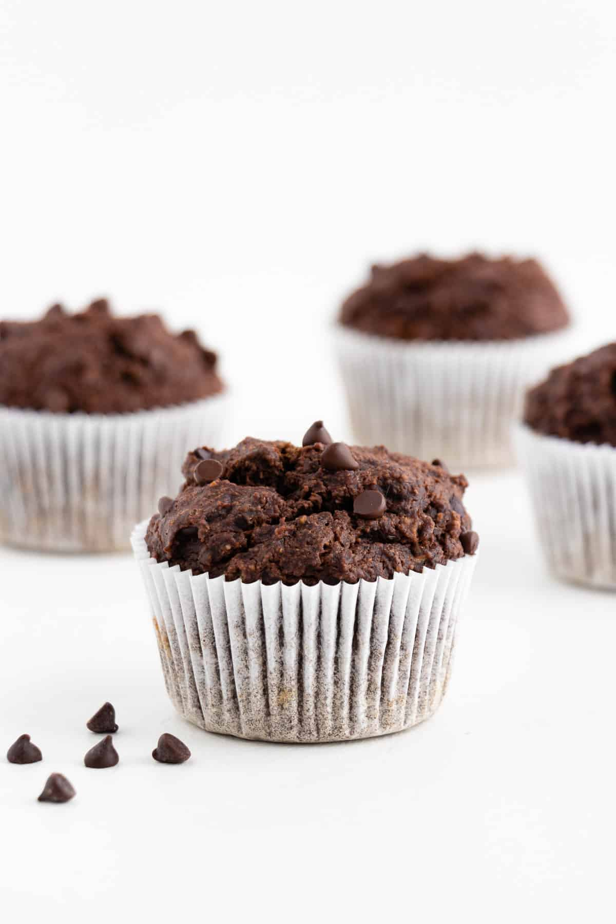 four vegan double chocolate banana muffins
