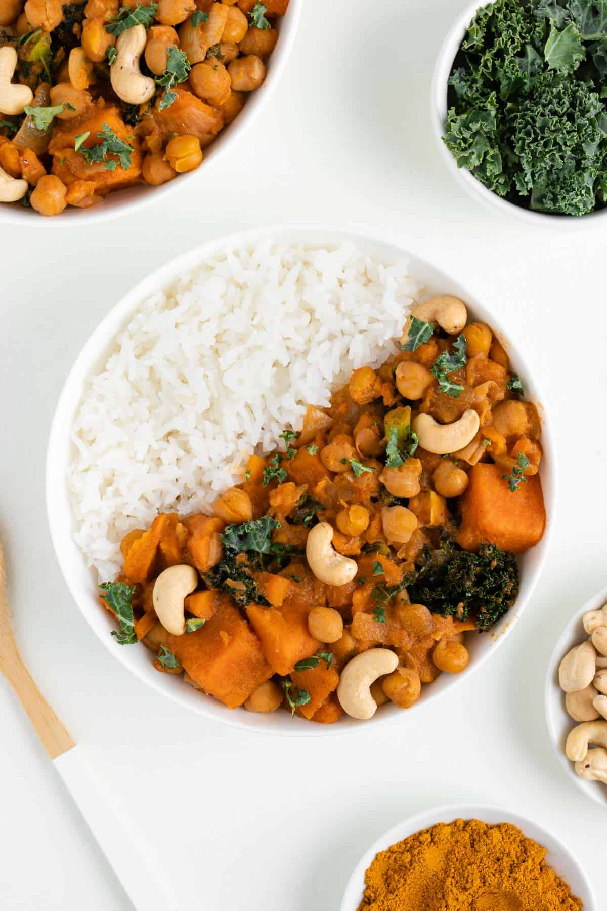 a bowl of sweet potato kale and chickpea curry with white rice