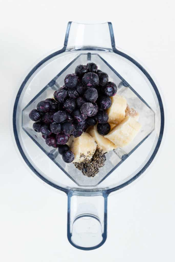 bananas, berries, and chia seeds inside a vitamix blender