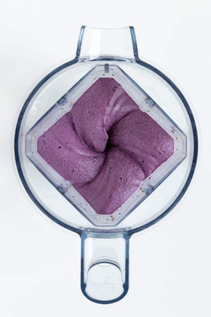 a purple smoothie inside a vitamix blender