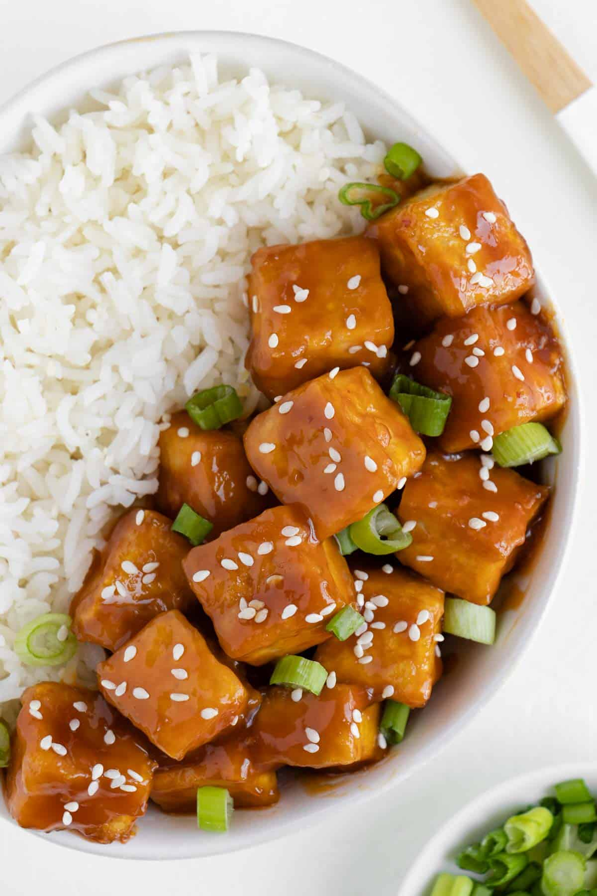 vegan orange tofu in a bowl with white rice
