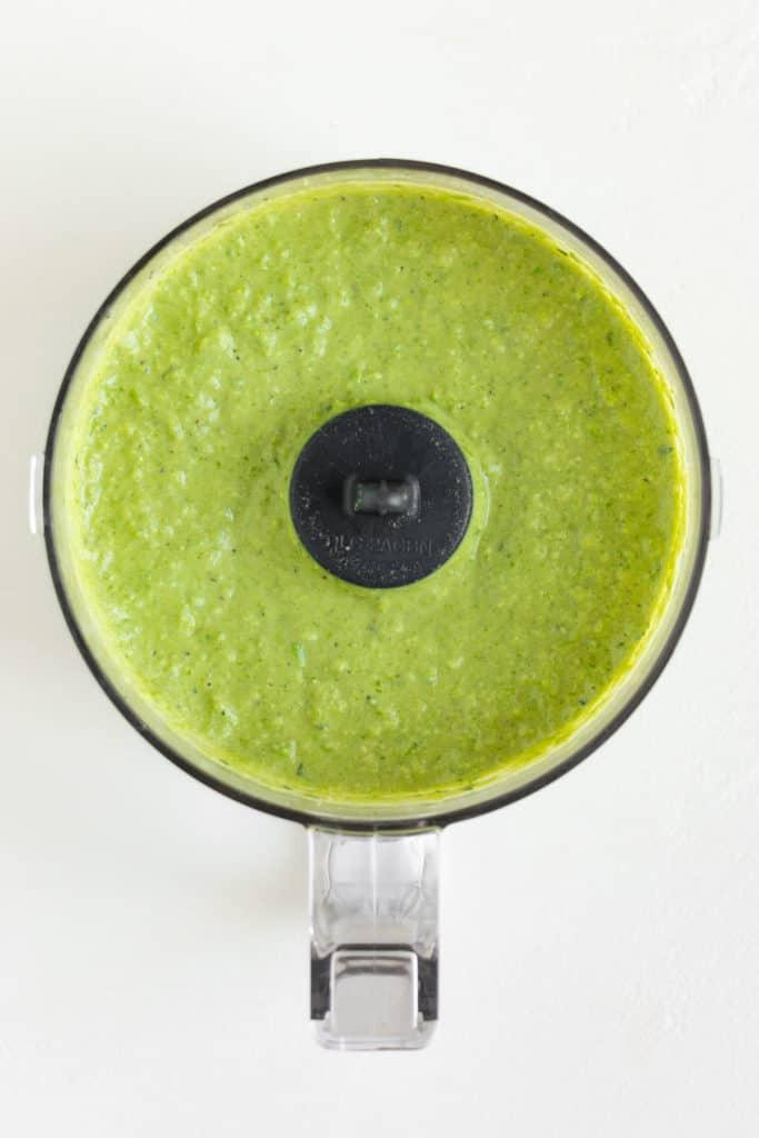 bright green spread inside a food processor