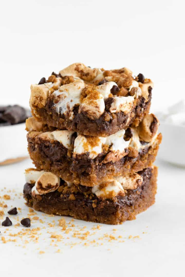three vegan s'mores bars stacked on top of each other