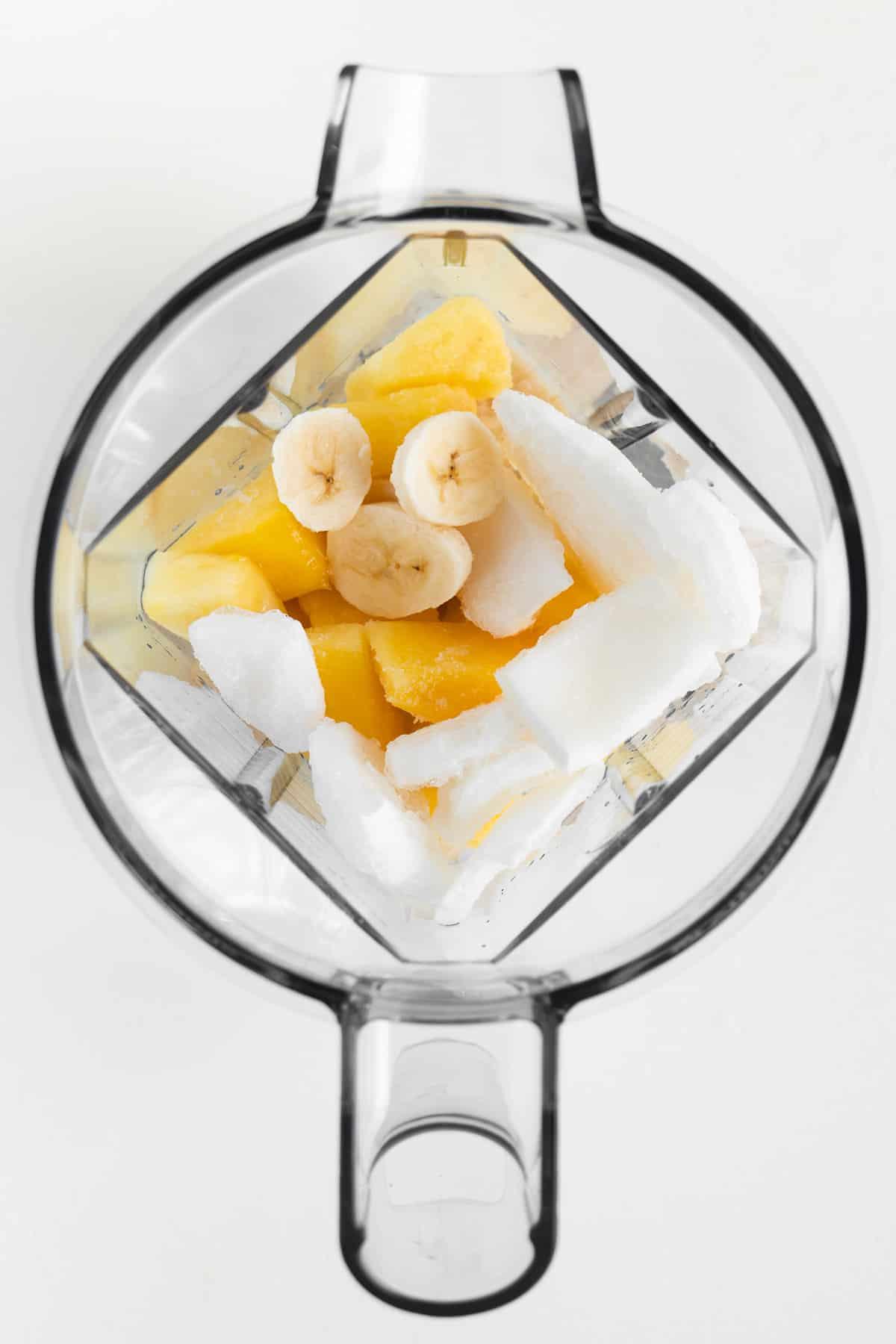 bananas, coconut, and pineapple inside a blender