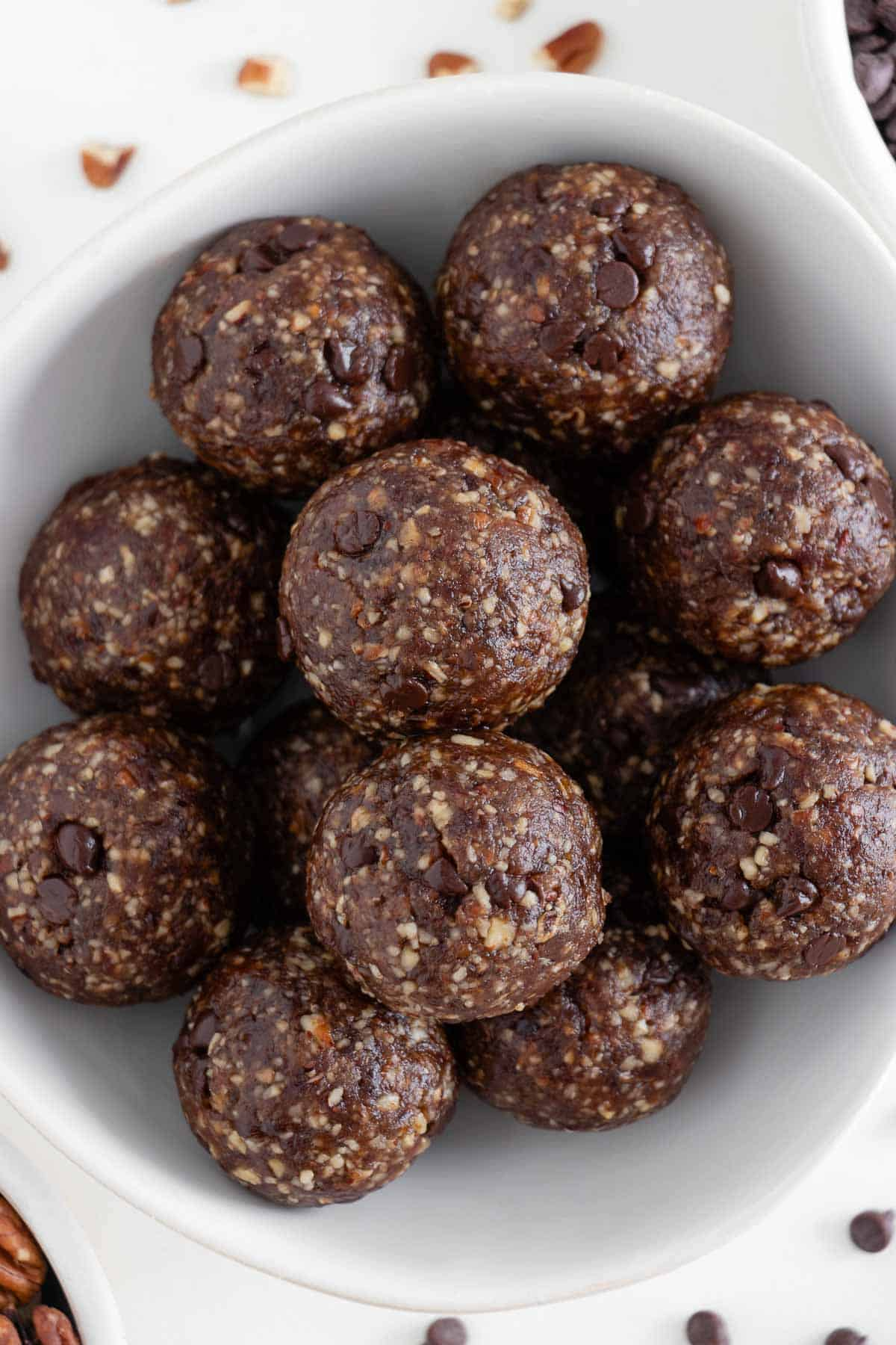 chocolate turtle energy balls inside a white bowl