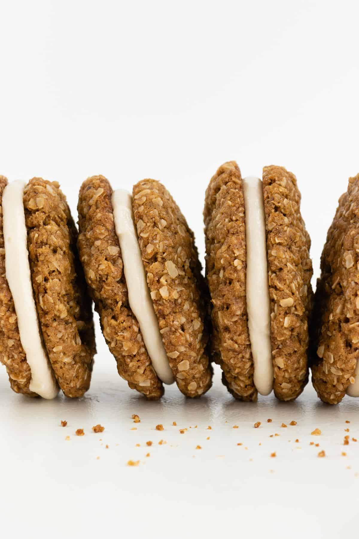a row of vegan oatmeal cream pie cookie sandwiches