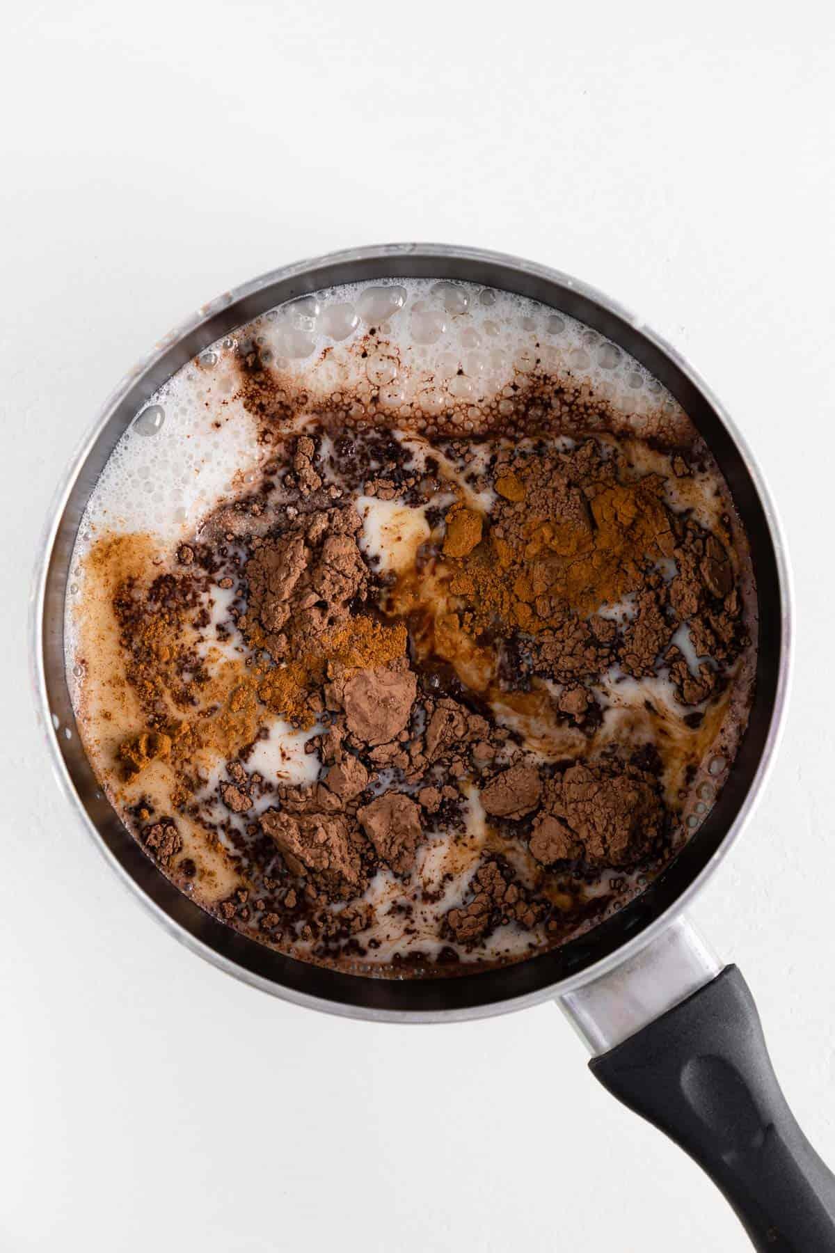 oat milk, cocoa powder, cinnamon, and vanilla extract in a small saucepot