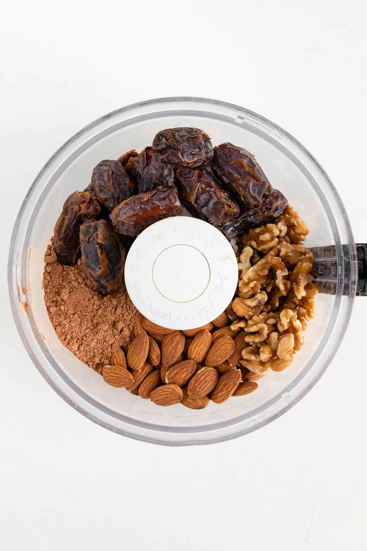 medjool dates, almonds, walnuts, and cocoa powder in a food processor