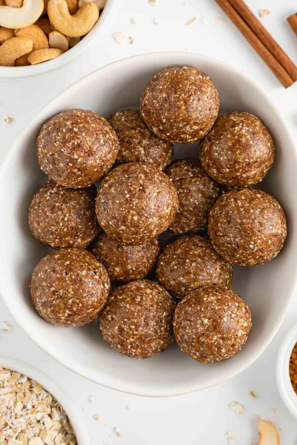 cinnamon roll energy balls inside a white bowl