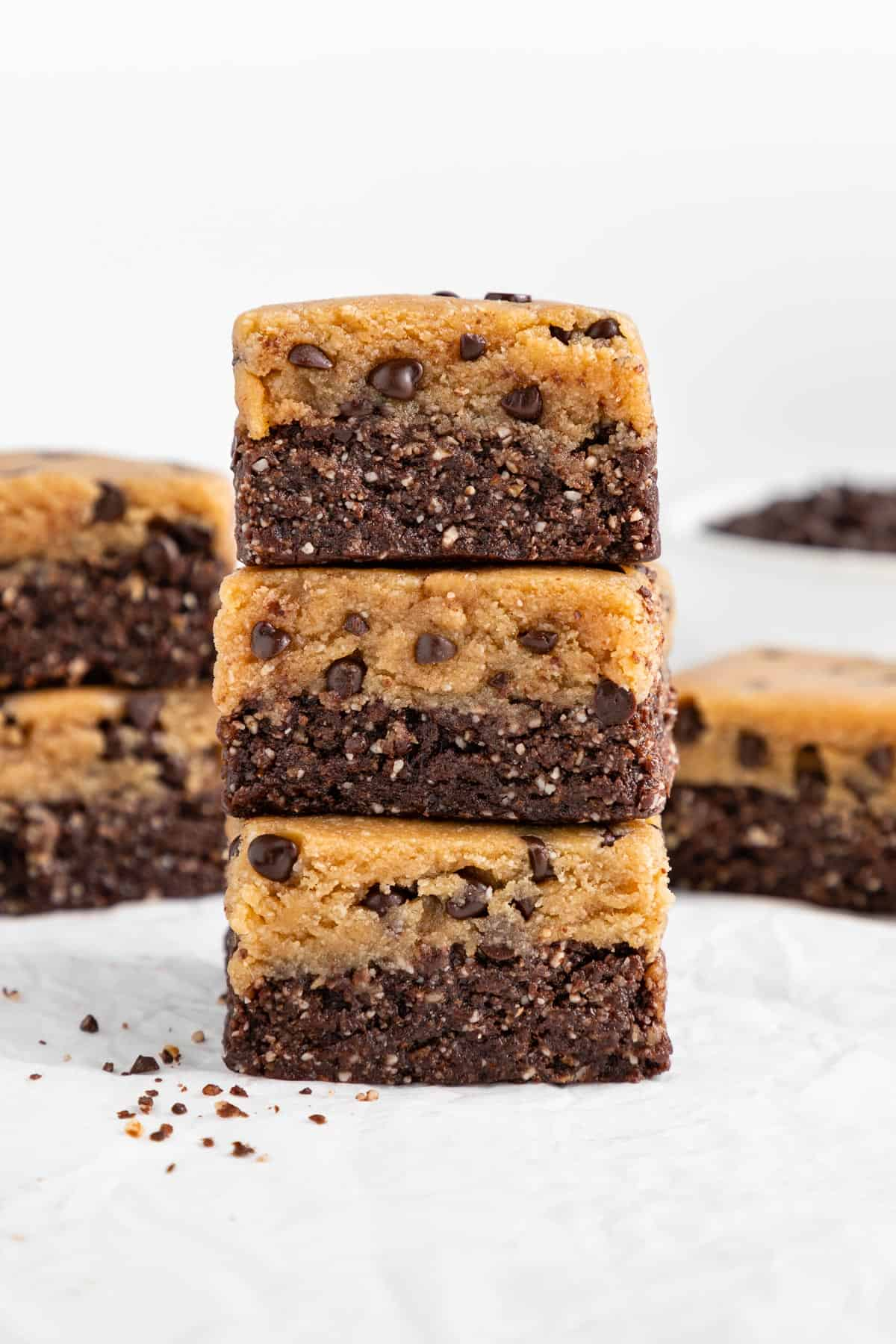 a stack of three no bake cookie dough brownies