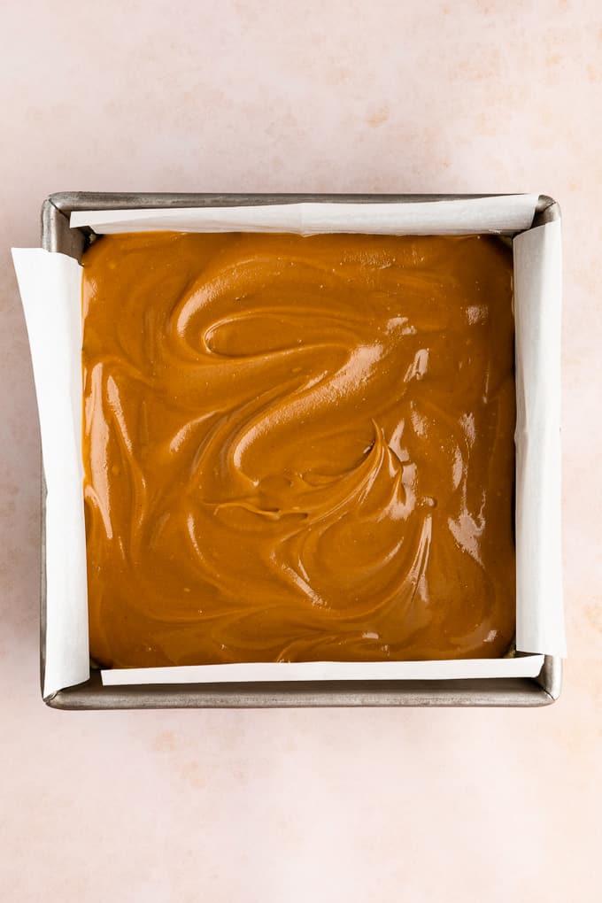healthy vegan caramel spread across a square baking dish