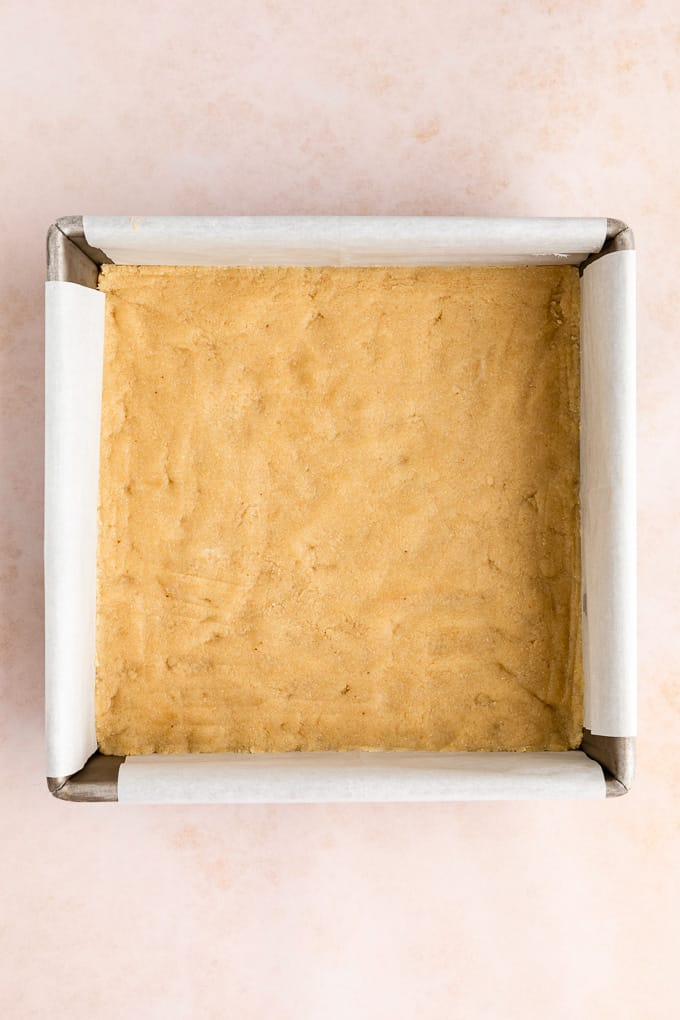 no-bake shortbread crust pressed across the base of a square baking dish