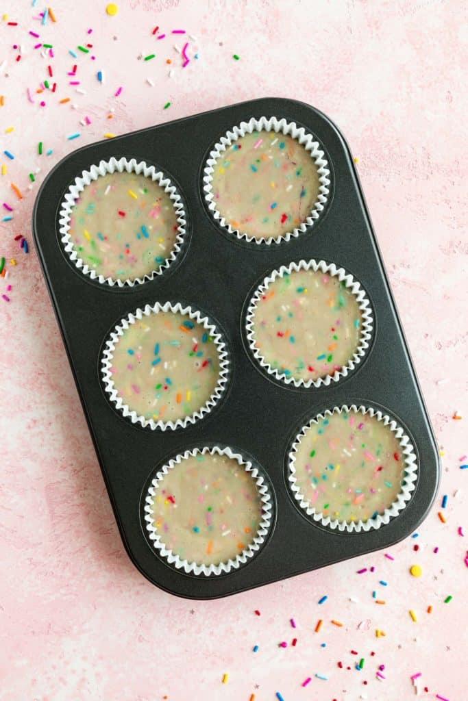 vegan funfetti cupcake batter inside a 6 slot cupcake tin